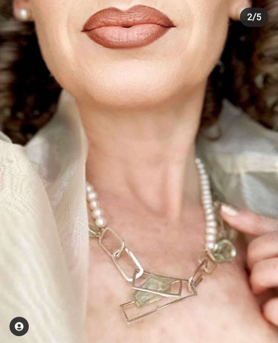 Nikki Oji wearing the green amethyst neckpiece