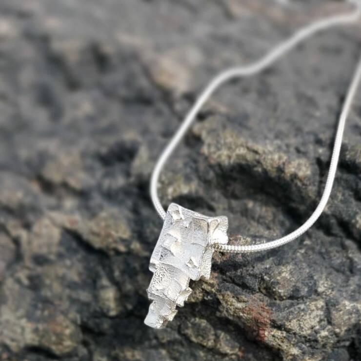 silver pyramid cube layered pendant
